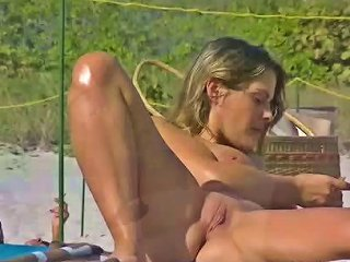 Exhibitionist Wife Teasing Nude Beach Voyeurs Next To Hubby